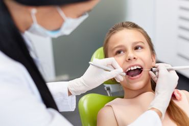 Dentist treating girl child